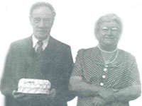 Lorne Hilbert Cooke (1878-1954) and Effie Blanche Vance Cooke (1887-1963) celebrating his 74th birthday, Portaupique, NS. George M. Cooke Collection